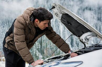 a man check a car system in winter